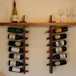 Joshua Rutherford - Wine Shelf - Introducing the Wine Shelf, part of the Honoring Fallen Trees - Shelving Collection. This simple zen like design is available in 4 unique urban salvaged hardwoods. You can choose from Claro Walnut, Mulberry, Valley Oak, and Silver Maple. Holds 14 bottles.
