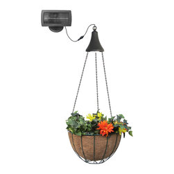 Gama Sonic Hanging Solar Accent Light with 6 Warm-White - The Gama Sonic GS-6 hanging solar LED spotlight provides warm light for your porch and deck. It also includes 22-inch chains and a metal hanging basket you can use to attach, display, and illuminate flowers or plants. The light fixture is made from durable, rustproof poly-resin and sports an attractive black finish. It measures 7 inches high and 5.5 inches in diameter. The external solar panel is 8 inches wide, 4 inches tall, 2 inches thick with a 4-inch mounting plate. No electrical wiring is required. Just hang the light on a hook and place the solar panel up to eight feet from the light for optimal sun exposure. The spotlight's  internal Lithium Ion battery pack charges when sunlight hits the solar panel. At sundown, the light's six warm-white LEDs turn on automatically and shine at a brightness of 40 lumens. The fixture is designed to operate for eight hours when the battery gets a full charge during the daytime. With proper setup for optimal sun exposure, a sunny day without cloud cover should be sufficient to provide a full recharge. Recharging speed will vary based on weather conditions, but no charging will occur if direct sun does not shine on the solar panel, so don't put the Premier lights in the shade. At Gama Sonic, our goal is to build the world's best solar lights.