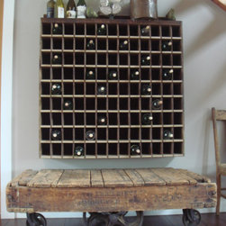re-tooled - Antique authentic cart.  Barn sale mail sorter converted into wine rack
