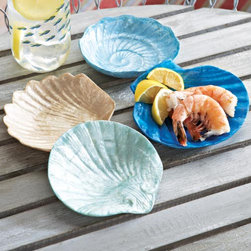 """Shell Appetizer Plates - Not simply a set: four one-of-a-kind pieces. Designed from capiz, a type of oyster shell native to the South Pacific, these plates are unique and delicate. The set ranges in color from translucent white to deep marine blue, with variations in the design of each plate. Capiz. Hand wash. Food safe. Handmade in the Philippines. 5"""" dia."""