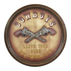 `Cowboys Leave Your Guns` Western Bar Sign - This cool Western style pub sign is a perfect accent to a home bar. Measuring 14 inches in diameter, the sign features bas relief crossed revolvers, with the legend `Cowboys Leave Your Guns At The Bar`. It hangs easily on your wall with a single nail.