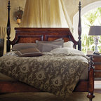 Stanley - The Classic Portfolio Four Poster Bed - Dreams will most definitely come lying in the romantic embrace of our Poster Bed. A bounty of decorative details set the Poster Bed apart, from the reeded posts on the headboard, crowned with regal finials, to the shell-like curve of the hand-carved cap rail ends.The stateliness of the bed is furthered by the decorative step molding and captured panels that distinguish the design''s headboard. The footboard offers its own style statement with two more finials and the collection''s signature fully-turned bun feet. Features: -Turned bun feet.-Hand-carved cap rail ends.-The Classic Portfolio Brit'sh Colonial Collection.-Distressed: Yes.Dimensions: -Overall Product Weight: 2 lbs.