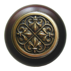 "Notting Hill - Notting Hill Fleur-de-Lis/Dark Walnut Wood Knob - Antique Brass - Notting Hill Decorative Hardware creates distinctive, high-end decorative cabinet hardware. Our cabinet knobs and handles are hand-cast of solid fine pewter and bronze with a variety of finishes. Notting Hill's decorative kitchen hardware features classic designs with exceptional detail and craftsmanship. Our collections offer decorative knobs, pulls, bin pulls, hinge plates, cabinet backplates, and appliance pulls. Dimensions: 1-1/2"" diameter"
