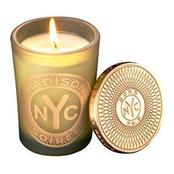 Bond No. 9 New York 'Madison Soiree' Candle - Lush femininity in an antique golden-yellow glass with a token-embossed top. Take-no-prisoners jasmine, combined with lush gardenia and honeysuckle, capture the after-hours verve of the world's grandest shopping street - when the world-class boutiques and museums have closed for the day, and the local denizens step out from their side-street townhouses, pervading the air with unabashed elegance. Brand: Bond No. 9. Style Name: Bond No. 9 New York 'Madison Soiree' Candle. Style Number: 671996.