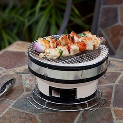 Well Traveled Living HotSpot Small Yakatori Charcoal Grill - Discover what the Japanese have known for centuries. The secret to perfect grilling is clay. The Yakatori table top grill is constructed of high fired ceramic clay which helps maintain a constant grilling temperature. Authentic Japanese street grill design. Adjustable ventilation.
