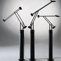 Artemide - Tizio 35 with Floor Lamp Support - The Tizio 35 Table Lamp with Floor Support features a floor support in lacquered steel with snap in adapter kit in molded thermoplastic.  The Tizio 35 is 20 percent smaller than the Tizio Classic.  Incorporated low voltage transformer and two intensity on/off switch.  Fully adjustable arms in anti corrosion treated aluminum.  Arm spacer bars in chromed steel with red, molded thermoplastic insulators and counterweights in zinc alloy.  Adjustable diffuser in die-cast aluminum with inner high efficiency reflector in anodized aluminum with UV protective glass.  360 degree rotatable base.  Finish for lamp with floor support available in Black only.  Floor support is 27 9/16 inches high x 3 15/16 inch diameter.  Tizio 35 lamp is 22 inches high x 25 5/8 inches deep x 39.25 inch maximum arm extension.  Includes one 35 watt GY6.35 halogen lamp.  UL listed.