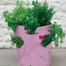 Strawberry Patio Planter - This strawberry planter looks like recycled pink jeans. I like these kinds of planters for more than just strawberries. Plant different varieties of herbs for a compact kitchen garden.