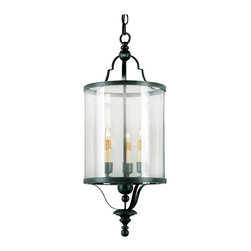 Kathy Kuo Home - Glass Cylinder Black Wrought Iron Lantern Pendant - Classic traditional metal lanterns get an elegant update in this three light wrought iron lantern. Curved lines and  precision welding make this an ideal piece for contemporary and traditional style spaces.