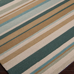 Surya Rain Dark Green Multi Stripe Rug 2x3 - The pale tan background of the Rain Multi Stripe Rug is played over by a dynamic pattern of bands in varying widths, hand-hooked in your choice of weathered blues, active brights, or rich muted earth tones.  Soft, durable fibers crafted in a pleasant medium pile can weather use as a living or dining area rug, but are also suitable for the deck or even the bath.  Bring transitional drama to your space with this dramatic striped floor covering.