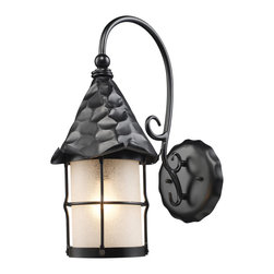 Elk Lighting - EL-385-BK Rustica 1-Light Outdoor Sconce in Matte Black and Amber Scavo Glass - Bring storybook flair to an old english, cottage or spanish revival-style home with the Rustica Collection. Hand-hammered iron and scavo seedy-glass cylinders characterize this series, which may be ordered in matte black (bk) with white scavo glass and antique copper (ac) with amber scavo glass. They may be used in both indoor and outdoor locations. (ul listed).