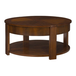 "Hammary - Maxim Round Lift Lid Cocktail Table - This sophisticated collection is characterized by bold, ingenous design features of wide banding & cross mullions that align with the legs. Crafted of Poplar Solids with Straight Grain Walnut Veneers in a Russet Brown Walnut finish. Maxim Round Lift Lid Cocktail Table; 2 Lift Tops with Storage Underneath; Casters; 1 Fixed Shelf; Dimensions: 38""W x 38""D x 18""H"