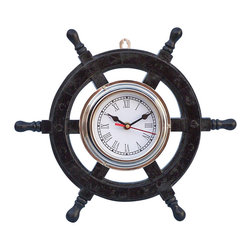 Handcrafted Nautical Decor - Deluxe Class Wood and Chrome Pirate Ship Wheel Clock 12'' - The Deluxe Class Wood and Chrome Pirate Ship Wheel Clock  12'' is one of our most popular decorative clocks. Made from rare, high quality Shisham  wood, this piece is sure to turn your space into a daring adventure. In addition, the chrome center of the wheel includes a real, working clock. The clock is   approximately 5-inches in diameter and rests perfectly inside the ship   wheel. This strong solid wood wheel also features a hinge on the back for easy placement and mounting. --This small wooden ship wheel clock  requires AA batteries to operate (not included) which can be easily  installed in the back. ------    Handcrafted from exotic solid Shisham wood with a chrome center--    Hand-sanded with extra coats of lacquer for a slight gloss--    Weather resistant - indoor and outdoor use--