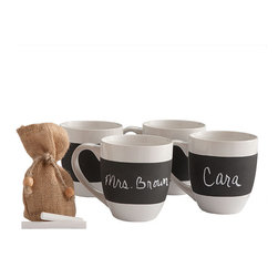Chalkboard Mugs - So much attention has been bestowed onto the coffee bean, isn't it time someone paid homage to the mug itself? This set of four ceramic mugs has a chalkboard exterior and comes with chalk. Holds 10 oz.
