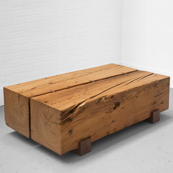 """Uhuru Design - BEAM COFFEE TABLE - The Beam Coffee Table is two 12"""" x 12"""" antique pine beams held together with two inset walnut feet and three walnut splines. It is finished to a smooth shine, yet retains the scars of its past, including nail holes and iron stains."""
