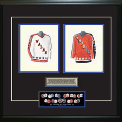 """Heritage Sports Art - Original art of the NHL 1985-86 NHL All-Star jersey - This beautifully framed piece features two pieces of original, one-of-a-kind artwork. Both images are glass-framed in an attractive two inch wide black resin frame with a double mat. The outer dimensions of the framed piece are approximately 28"""" wide x 24.5"""" high, although the exact size will vary according to the size of the original art. At the core of the framed piece is the actual piece of original artwork as painted by the artist on textured 100% rag, water-marked watercolor paper. In many cases the original artwork has handwritten notes in pencil from the artist. Simply put, this is beautiful, one-of-a-kind artwork. The outer mat is a rich textured black acid-free mat with a decorative inset white v-groove, while the inner mat is a complimentary colored acid-free mat reflecting one of the team's primary colors. The image of this framed piece shows the mat color that we use (Medium Blue). Beneath the artwork is a silver plate with black text describing the original artwork. The text for this piece will read: This is an original watercolor painting of the 1985-86 Wales Conference NHL All-Star jersey and a reproduction of the 1985-86 Campbell Conference NHL All-Star jersey. These jersey images have been, and continue to be, used to celebrate the history of the NHL All-Star game in posters like the one shown below as well as game programs, magazines and websites across North America. Beneath the silver plate is a 3"""" x 9"""" reproduction of a well known, best-selling print that celebrates the history of the team. The print beautifully illustrates the chronological evolution of the team's uniform and shows you how the original art was used in the creation of this print. If you look closely, you will see that the print features the actual artwork being offered for sale. The piece is framed with an extremely high quality framing glass. We have used this glass style for many years with excellent r"""