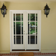 Traditional Windows And Doors Custom Lite French Doors to rear terrace, casement windows w/ SDL pattern