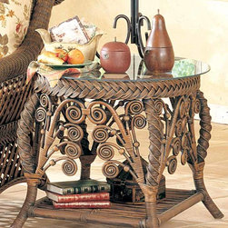 Spice Island Wicker - Decorative Rattan & Wicker End Table (Brown Wash) - Finish: Brown WashCircular end table will complement any wicker entertainment setting with beveled glass top supported by large-braid framing.  It�۪s whimsically detailed with ornamental curled rattan and woven leg supports that are shapely in a subtle S-curve.  Choose a natural or white finish to suit your style.  Artfully formed and crafted under the hands of an experienced master, this exquisitely beautiful wicker end table comes complete with the stylish and tasteful braided edges and artful yet tasteful flourishes that make it uniquely beautiful whether in a white, white wash, or brown wash finish.  This distinctively different Decorative Rattan/Wicker End Table boasts solid wicker construction in your choice of White, White Wash or Brown Wash finishes. * Solid Wicker Construction. For indoor, or covered patio use only. Includes Glass. 26 in. x 30 in. x 24 in.