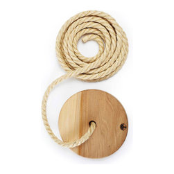 The Wandawega Tree Swing - Embrace the spirit of childhood by hanging one of these solid wood rope swings from a tree outside. Nearby watering hole optional.