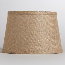 World Market - Natural Burlap Accent Lamp Shade - Soft light filters through our Natural Burlap Accent Lamp Shade, casting a warm glow on your space. This eco-chic shade is made from 100% burlap, a wonderfully versatile material that offers a rustic look.