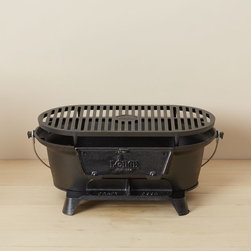 Lodge Cast Iron Hibachi Grill - In the summertime I avoid turning on the stove at all costs, but this Lodge hibachi grill would be perfect for doing a little bit of cooking alfresco.