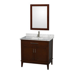Wyndham Collection - 36 in. Eco-Friendly Single Bathroom Vanity - Includes white Carrera marble countertop with backsplash and undermount square sink. Faucet and mirror not included. Two functional doors. Pre-drilled for single hole faucet. 12 stage wood preparation, sanding, painting and hand-finishing process. Highly water-resistant low V.O.C. sealed finish. Practical floor-standing design. Deep doweled drawers. Fully-extending under-mount soft-close drawer slides. Concealed soft-close door hinges. Single faucet hole mount. Plenty of storage and counter space. Metal exterior hardware with brushed chrome finish. Engineered to prevent warping and last a lifetime. Made from zero emissions solid birch hardwood. Dark chestnut finish. Vanity: 35 in. W x 21.5 in. D x 34.25 in. H. Vanity with Countertop: 36 in. W x 22 in. D x 35 in. H. Countertop: 36 in. W x 22 in. D x 0.75 in. H. Backsplash: 36 in. W x 0.75 in. D x 3 in. H. Warranty. Care Instructions. Counter Handling Instructions. Installation InstructionsBring a feeling of texture and depth to your bath with the gorgeous Hatton vanity series. A contemporary classic for the most discerning of customers. The Wyndham Collection is an entirely unique and innovative bath line. Sure to inspire imitators, the original Wyndham Collection sets new standards for design and construction.