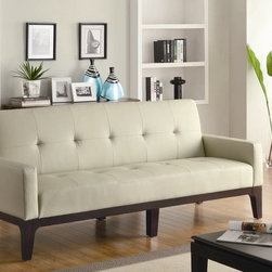Coaster - Creme Leather Like Vinyl Sofa Bed - This casual styled Sofa Bed by Coaster is covered in a durable leather like Crème vinyl, which creates a great look and feel. Padded track arms and tufted seating add to the casual styling. Exposed wood base is finished in Cappuccino.