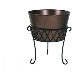 Highland Planter with Stand - Durable enough for commercial use but elegant enough to suit the home, the planter features a sleek powder coated bronze planter with rich color. The top vessel measures 12 inches diameter and stands at 8 inches in height, making it ideally sized for flowers. Drain holes are integrated into the design and are outfitted with rubber stoppers to make the planter suitable for indoor use. The simple, modern lines of the planter contrast with the intricate forms of the base.