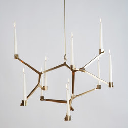 Agnes Hanging Candelabra - 10 Candles - Candlelight can imbue any space with a bit of romance and drama, but this candelabra by Lindsey Adelman takes it to a whole new level. Can you imagine hosting a dinner party under the flickering light from this fixture above? Now that's creating atmosphere.