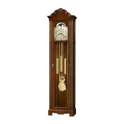 Howard Miller - Nicea Floor Clock in Cherry Finish - Saratoga Cherry finish on select Hardwoods and Veneers. Bonnet pediment features a dramatic carved shell framed by stepped swan neck pediment moldings. Base includes a decorative cutout. Polished Brass dial offers ornate corner spandrels, center disk, Silver chapter ring with Black Arabic numerals, and a stationary blue moon phase. Polished Brass finished pendulum and weight shells. Elegant columns frame the door which features crystal-cut V-grooved Glass. Removable Glass topside panels offer easy access to the movement. Locking door for added security. Adjustable floor levelers under all four corners level the clock on uneven and carpeted surfaces. Chain-driven, Westminster chime Kieninger movement features a chime silence option. 19 1/2 in. W x 11 1/4 in. D x 75 1/2 in. H