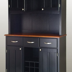 HomeStyles - Buffet with Hutch in Black Finish - Combine the value of hidden storage space with all your service and display needs.  This buffet is full of old-fashioned features, including double paned doors in the hutch and a cottage oak finish on the service surface.  Utility drawers are perfect for utensils while central cubby lets your showcase wine. * Buffet with three utility drawers. Two wood framed cabinet doors with an adjustable shelf for plenty of inside storage. Center wine storage area. Hutch with two wood framed plexiglas doors with an adjustable shelf inside. Center area with one shelf. Brushed steel hardware. Adjustable floor levelers. Made from Asian hardwood. Made in Thailand. Assembly required. 44 in. W x 17 in. D x 72.25 in. H
