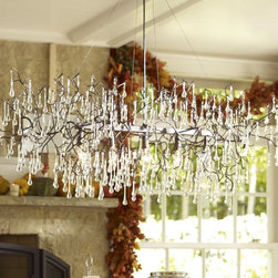 Lucinda Branch Chandelier - Winter light reflects cheerfully among icicles you can bring indoors in this chandelier. I also love the tangles of its bare branches.
