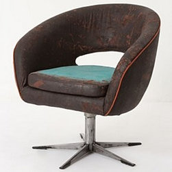 """Draga Obradovic - Turquoise Glow Chair - Our buyer fell in love with Serbian artist Draga Obradovic's one-of-a-kind chairs at her studio in Como, Italy, where she reupholsters vintage frames in her signature coated-cotton canvas fabric. Layered with rich pigment then screenprinted and hand-distressed, each chair ends up with a durable, leather-like finish. This curvy, circa 1950 swivel chair is finished with a pop of blue at the seat. One of a kind Coated cotton upholstery Metal frameWipe clean 29""""H, 27""""W, 23""""DSeat: 16.5""""HHandmade in Italy"""