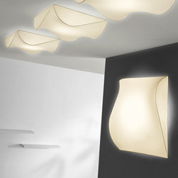 AXO Light - AXO Light | Stormy 100 Ceiling or Wall Light - Design by Manuel Vivian, 2010.The Stormy 100 Ceiling or Wall Light features a removable and washable elastic fabric covering, available for indoor installation, with shades in white or ivory.