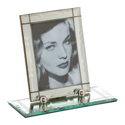 Chantilly Rectangle Mirrored Picture Frame - 4.5 x 6.5 - Reminiscent of antique picture frames that once graced the desks of English squires, the Chantilly Rectangle Mirrored Picture Frame is instantly classic yet undeniably modern. The mirrored frame, with delicately beveled detail, sits atop a mirrored base that elevates a cherished photograph, an artfully displayed page of a long-ago letter, or a timeless memento.