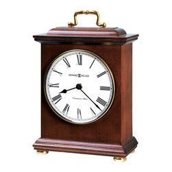 "Howard Miller - Howard Miller - Tara Mantel Clock - Howard Miller outdoes himself timelessly. Rich wood finishes combine with sleek metal and brass handles. Mobile timepiece creates a sense of tradition within any ambiance to transform the d̩cor into an upscale posh pleasantry. Invest in quality with this selection. * Bracket-style clock brings charm to any shelf or mantel. Features a decorative brass-finished handle, polished brass finished bezel. Turned, polished brass bun feet . An off-white dial under convex glass features black Arabic numerals and black hands. . Finished in Windsor Cherry on select hardwoods and veneers. . Automatic nighttime chime shut-off option. . Quartz movement plays Westminster chimes on the hour. . H. 10"" (25 cm). W. 6-1/2"" (17 cm). D. 3-1/4"" (8 cm)"