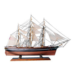 "Handcrafted Model Ships - Cutty Sark Limited 32"" - Large Model Ship - Sold Fully Assembled This is NOT a model ship kit. One of the fastest clipper ships of the late 19th Century, some say even the fastest of its kind, the Cutty Sark was an impressive vessel in the tea trade between China and London. With a fascinating history and scintillating name, this stunning replica makes a fabulous addition to any room or office. Enjoy the warmth of its sleek nautical style, a design that is a true classic, and place this replica proudly upon the mantel, above the fireplace, or on your desk. 32"" Long x 7"" Wide x 21"" High (1:127 scale)."