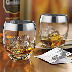 Silver Rim Whiskey Glasses - Set of 2 - Whether you take yours neat or on the rocks, whiskey just tastes better when it�ۡ���_s served in a silver-rimmed glass. The mid-century inspired pieces are perfect for entertaining at home or at the office, and up the cool factor of whiskey-drinking in any space.
