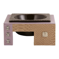 Frontgate - Mojave Tan Lavender Limited Dog Bowl - Handmade raised dog feeder. Leather backing and top surface. Comes with a black ceramic bowl. There's no reason that your pet's housewares can't complement – rather than tarnish – your interior design. And our Mojave Tan Lavender Limited Dog Bowl goes one step further – providing a functional work of art. This elevated feeder has a sleek modern shape, covered with Italian leather with a snakeskin finish and chrome-plated bone details with hand-set Swarovski crystals.  .  .  .