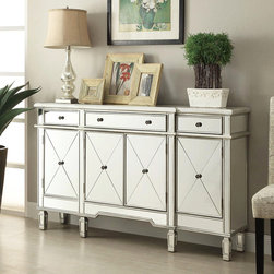 """Accent Cabinet in Antique Silver Finish - This beautiful Accent Cabinet finished in antique silver. This piece features four doors and three top drawers. Each cabinet door is decorated with a sleek """"X"""" pattern and round knobs in the center."""