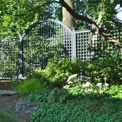 Verde Lattice Fence - This appealing natural setting is embellished by the subtlety and sophistication of a Verde green lattice fence with arched decorative panel.
