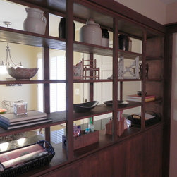 Broderick Home Staging - This bookcase was originally filled with family pictures.  I removed all the framed photos and used pottery and architectural pieces allowing natural light to past through the bookcase openings.