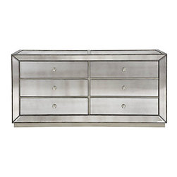 Omni Mirrored 6 Drawer Chest - Our Omni Collection demonstrates a striking use of style and restraint. While elegantly reflecting its surroundings this functional collection combines glamor with purpose. The clean lines of the cases are outlined in a hand applied silver leaf and silver beaded trim while the drawers are accented with a brushed silver hardware.