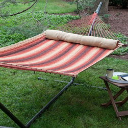 Island Bay - Island Bay Dura-Weave Quilted Hammock with Steel Stand - DP131 - Shop for Hammocks from Hayneedle.com! Additional features: Stand dimensions: 13 - 15 ft. L x 4 ft. W x 3 ft. 9 in. H Dura-Weave fabric is water- mildew- and UV-resistant for lasting use 100% FSC-certified wood spreader bars UV-resistant polyester rope Hanging distance min/max: 13 ft./16 ft. Zinc-plated hanging hardware included Hammock comes with an FSC-certified hang tag Perfect for cuddling up with a good book or enjoying an afternoon siesta the Island Bay Dura-Weave Quilted Hammock with Steel Stand is as fetching as it is functional. Made of soft yet extremely durable water- mildew- and UV-resistant Dura-Weave fabric that will offer years of enjoyment this hammock also scores high in the comfort factor. You ll be enveloped in such luxury thanks to the soft fabric and the coordinating bolster pillow that you might find yourself spending more time outdoors than you ve ever done before! Choose from several striped patterns to brighten up your outdoor setting. Responsibly harvested Forestry Stewardship Council (FSC)-certified spreader bars hold the hammock open for easy getting in and out. It has a weight capacity of 450 pounds and the dimensions of the bed itself are 6 feet 8 inches in length and 4 feet 6 inches in width. Powder-coated for weather- and rust-resistance the heavy-duty steel stand is built to last and comes in a choice of finishes to enhance the beauty of your hammock. One of our most beloved hammocks the Island Bay Dura-Weave Quilted Hammock has constantly topped our customer favorite list. Taking a cue from that we ve paired this hammock with one of our sturdiest most trusted hammock stands so you can enjoy your new hammock immediately and start making the most of summer! If you want to make your summers memorable you won t go wrong with this hammock set. About Dura-Weave Equivalent to well-known Sunbrella fabrics in durability and weather-resistance Dura-Weave textiles consist of 100% solution-dyed polyester with an impressively long colorfast life. Designed for those who want the softness and comfort of cotton with the strength of polyester Dura-Weave rope and quilted hammocks offer exceptional quality at a much more economical price than similar quality hammocks. Rigorous testing has proven Dura-Weave's ability to withstand fading tearing rubbing weathering and even melting. You can count on Dura-Weave to be extremely UV-resistant - this textile has 1000 hours of colorfastness. Dura-Weave quilted and rope hammocks are mildew-resistant and water repellent. They won't snag tear or wear out easily and they're age-resistant. Dura-Weave is a textile you can count on to look good and stay strong season after season. About Island Bay HammocksIsland Bay Hammocks come to you directly from skilled hammock artisans and feature the Island Bay logo on the spreader bar. Using the latest technology alongside time-tested traditional methods of construction these hammocks are woven with the pride of their makers.
