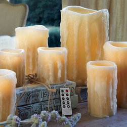 Fabulous Flameless Candles - The appearance of luxury candles, having burned for hours...these wax imposters each come with a convenient remote and have a built in timer for ultimate convenience.