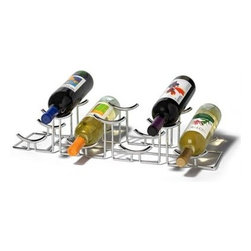 "Spectrum Diversified Design - Euro Hilo 7-Bottle Wine Rack - Chrome - Spectrum's Euro HiLo 7-Bottle Wine Rack combines a stylish look with space-saving convenience. The unique design keeps wine bottles at the proper angle to help prevent corks from drying. Made of sturdy steel this wine rack will add a modern touch to your home.  CareWipe with a damp cloth and towel dry.FeaturesStores bottles at the proper angle to help prevent corks from dryingStylishly stores and displays up to seven bottles of wine on any countertop or barSturdy steel construction Product SpecificationsHeight:5""Width:5 1/2""Depth:23 1/4"""