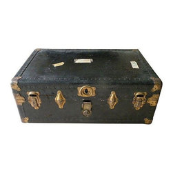 """Used Vintage Steamer Trunk - Pack it in to this robust black steamer trunk. Well traveled with tags to prove it! This piece makes a great coffee table or accent piece. Plenty of storage. 32"""" x 21"""" x 11.5"""". Thick leather straps to boot."""