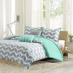 Intelligent Design - Intelligent Design Nadia Comforter Set - Nadia makes any bedroom fun and inviting. The comforter features a fresh solid teal color with a gray and white chevron print that runs along the bottom broken up by white vertical stripes. The sham features the coordinating gray and white chevron pattern with a teal flange. The comforter and shams reverse to a solid gray color. The set comes with two coordinating teal and gray decorative pillows. Comforter & Sham: 100% polyester peach skin printed fabric, 100% polyester brushed fabric reverse, 200g poly fill Pillow: poly cover and poly fill