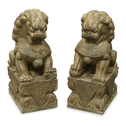 China Furniture and Arts - Hand Carved Stone Foo Dogs - Always standing in pairs, Foo Dogs are fantasy lions in Chinese mythology who serve as guardians to prevent harmful things from happening to the family. This handsome pair are standing in commanding posture. The male, with a paw on a symbolic ball, protects the world, while the female, with a paw on a cub, protects the dwelling. A grand reproduction of the pair of Foo Dogs that guard the front gate of the Forbidden City in Beijing, China. Completely hand carved in stone. Each one weighs approximately 150lbs. For indoor or outdoor use.