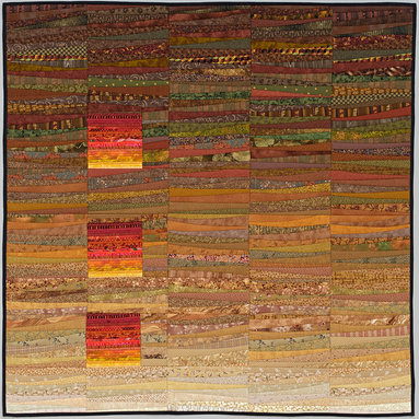 """Available work - Through the golden sky of autumn, there are entrances made by contrasting the free form wedges with the very tight straight line piecing. Quilt made by the artist of commercially available cotton fabrics using a method she calls quilt as you go. 45 x 45""""  Orders taken. Photo by John Polak"""