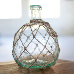 Glass Catch Accent - For a unique and decorative accent for your shelf or tabletop vignette, look to the Glass Catch Accent. This beautiful glass container, covered with twine netting, imitates an old-fashioned fishing float to add a natural, elegant touch to your d̩cor.